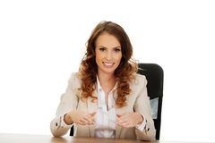 Businesswoman presenting something in hands. Stock Images