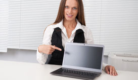Businesswoman presenting something on a laptop screen Stock Photo