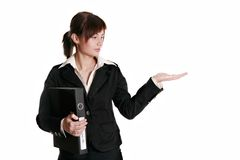 Businesswoman is presenting something Royalty Free Stock Image