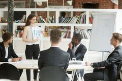 Businesswoman presenting design project to investors, showing cl. Businesswoman presenting startup design project to investors, manager designer shows clients royalty free stock photo