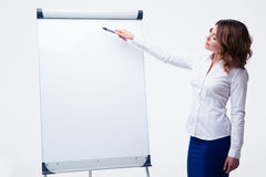 Businesswoman presenting strategy on flipchart. Beautiful businesswoman presenting strategy on flipchart isolated on a white background Stock Photo