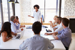 Businesswoman Presenting To Colleagues At A Meeting Stock Photos