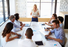 Businesswoman presenting to colleagues at a meeting Royalty Free Stock Photography