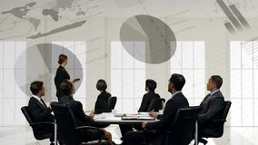 Businesswoman presenting to a group of business people stock footage