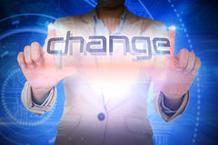 Businesswoman presenting the word change Stock Photography