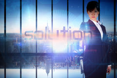 Businesswoman presenting the word solution Stock Images