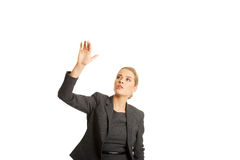 Businesswoman pressing an abstract button Stock Photos