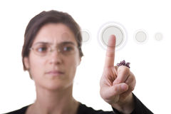 Businesswoman pressing a button Stock Images
