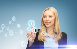 Businesswoman pressing button with contact Royalty Free Stock Image