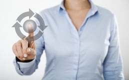 Businesswoman pressing button on the digital touch screen Royalty Free Stock Photography