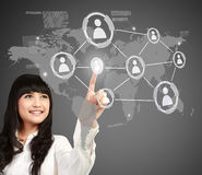 Businesswoman pressing button of social media. Asian Businesswoman pressing button of social networking concept Royalty Free Stock Images