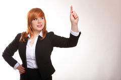 Businesswoman pressing button or something. Stock Images