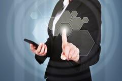 Businesswoman pressing button on touchscreen interface Stock Photos