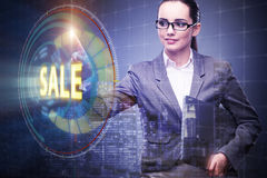 The businesswoman pressing buttons in sale concept Stock Images