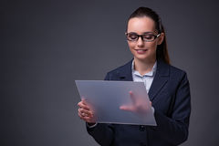 The businesswoman pressing buttons on tablet Royalty Free Stock Photos