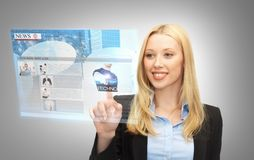 Businesswoman pressing buttons on virtual screen Royalty Free Stock Photo
