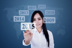 Businesswoman pressing high tech button Royalty Free Stock Images