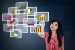 Businesswoman pressing high tech interface Royalty Free Stock Images