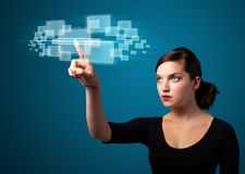 Businesswoman pressing high tech type of modern buttons royalty free stock photography