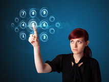 Businesswoman pressing high tech type of modern buttons Royalty Free Stock Image