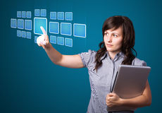 Businesswoman pressing high tech type of modern buttons Stock Photos