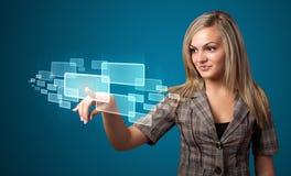 Businesswoman pressing high tech type of modern buttons Stock Photos