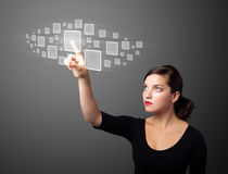 Businesswoman pressing high tech type of modern buttons Royalty Free Stock Photos