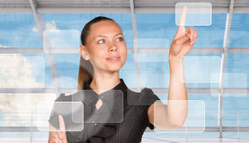 Businesswoman pressing on holographic screen Stock Image