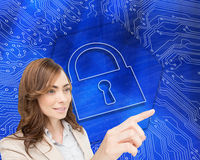 Businesswoman pressing an invisible key Royalty Free Stock Photo
