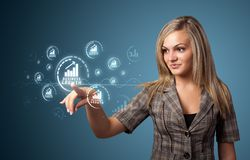 Businesswoman pressing modern business type of buttons royalty free stock photos