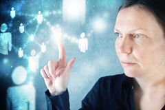 Businesswoman pressing modern display on social networking schem Royalty Free Stock Image