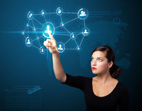 Businesswoman pressing modern social type of icons Stock Photos