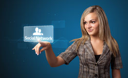 Businesswoman pressing modern social type of icons Royalty Free Stock Photos