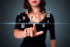Businesswoman pressing modern social type of icons Stock Image
