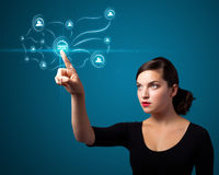 Businesswoman pressing modern social type of icons Stock Photo