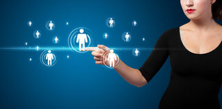 Businesswoman pressing modern social type of icons Royalty Free Stock Images