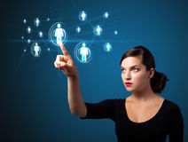 Businesswoman pressing modern social type of icons Stock Images