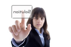 Businesswoman pressing the solution button Stock Photo