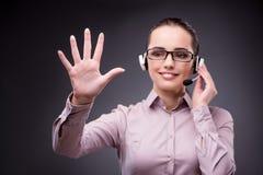The businesswoman pressing virtual button in business concept. Businesswoman pressing virtual button in business concept Royalty Free Stock Image