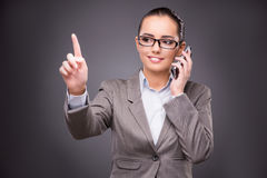 The businesswoman pressing virtual buttons in business concept Royalty Free Stock Photography