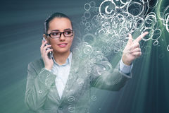 The businesswoman pressing virtual buttons in business concept Stock Image
