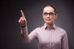 The businesswoman pressing virtual buttons in business concept Stock Photos
