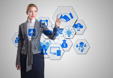 The businesswoman pressing virtual buttons in business concept Royalty Free Stock Images