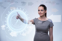 The businesswoman pressing virtual buttons in futuristic concept Stock Photography