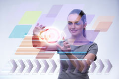 The businesswoman pressing virtual buttons in futuristic concept Stock Photos