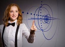The businesswoman pressing virtual buttons in futuristic concept Royalty Free Stock Photos