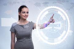 The businesswoman pressing virtual buttons in futuristic concept Royalty Free Stock Photo