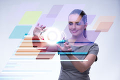 The businesswoman pressing virtual buttons in futuristic concept. Businesswoman pressing virtual buttons in futuristic concept Royalty Free Stock Images