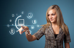 Businesswoman pressing virtual media type of buttons stock image