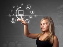 Businesswoman pressing virtual media type of buttons royalty free stock images